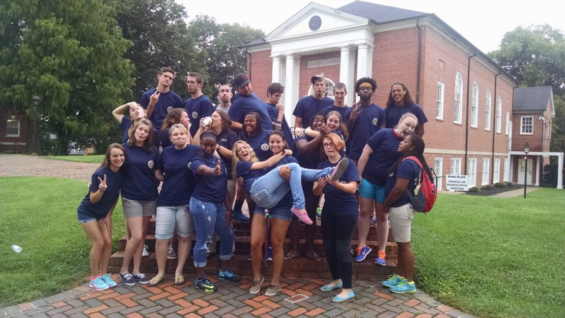 Students make silly pose outside chapel